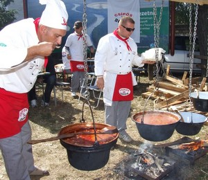 Hungarian chefs cook goulash on the street in bowlers