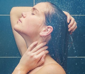 Girl standing in the shower