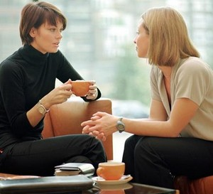 Two women chatting over tea