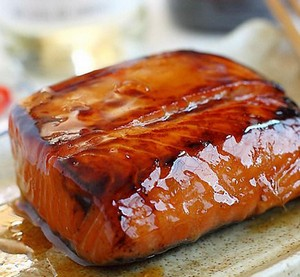 A slice of fish in teriyaki sauce