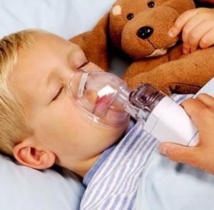 Boy breathes through an inhaler