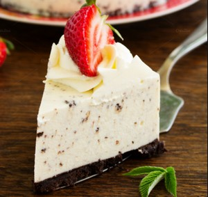 A slice of cheesecake with strawberries