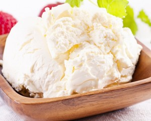 Mascarpone cheese in a wooden bowl