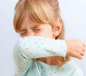 Girl sneezing in hand