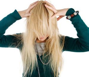 Blonde holding her head