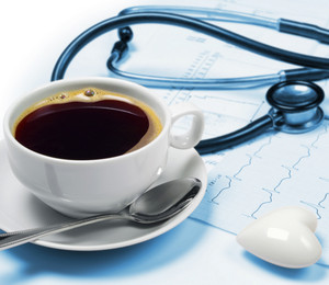 Cup with coffee and cardiogram