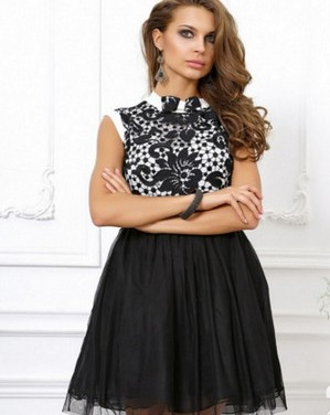 Girl in a black and white dress with a fluffy skirt