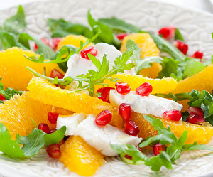 Salad with chicken fillet, orange and pomegranate