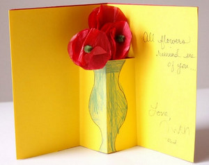 Yellow card with red flowers