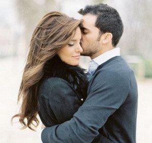Man hugs woman and kisses on cheek