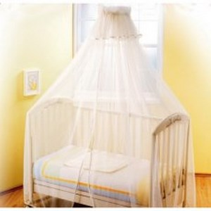 White canopy that covers the entire crib