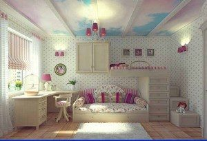 Children's room with a sofa, a bed and a table in pink and white colors