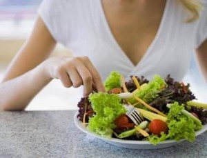 Girl eats vegetable salad