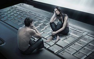 Girl with a guy sitting on the keyboard