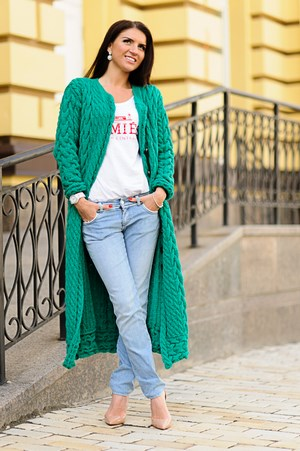 Girl in a long green cardigan