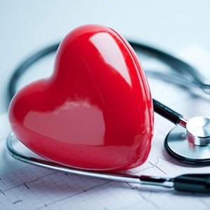 Heart figurine and stethoscope