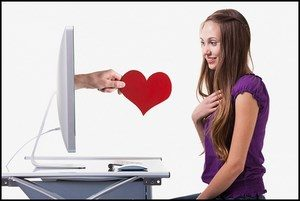 A hand with a heart leans out of the monitor, the girl is surprised