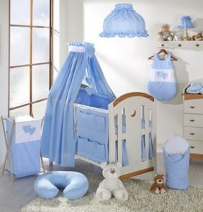 Room in blue with a canopy, crib