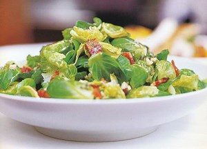 Salad of Brussels sprouts and greens in a plate