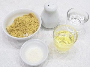 Water, vinegar, salt, oil and dry mustard in bowls