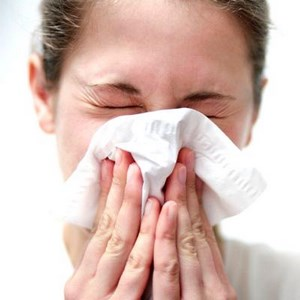 Girl with paper napkins wipes her nose