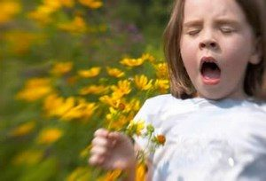 The child on the field sneezes