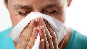 The girl wipes her nose