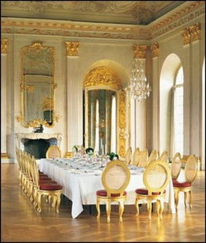 Dining room with huge table and high ceilings