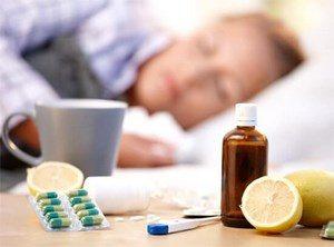 Tablets, tea, lemon and drops on the table