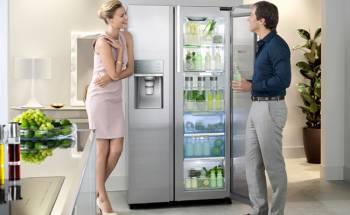 girl and man flirt by the fridge