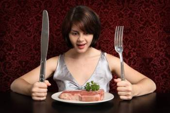 girl with a huge knife fork and steak