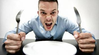 man in front of an empty plate